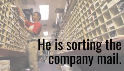 he is sorting the company mail